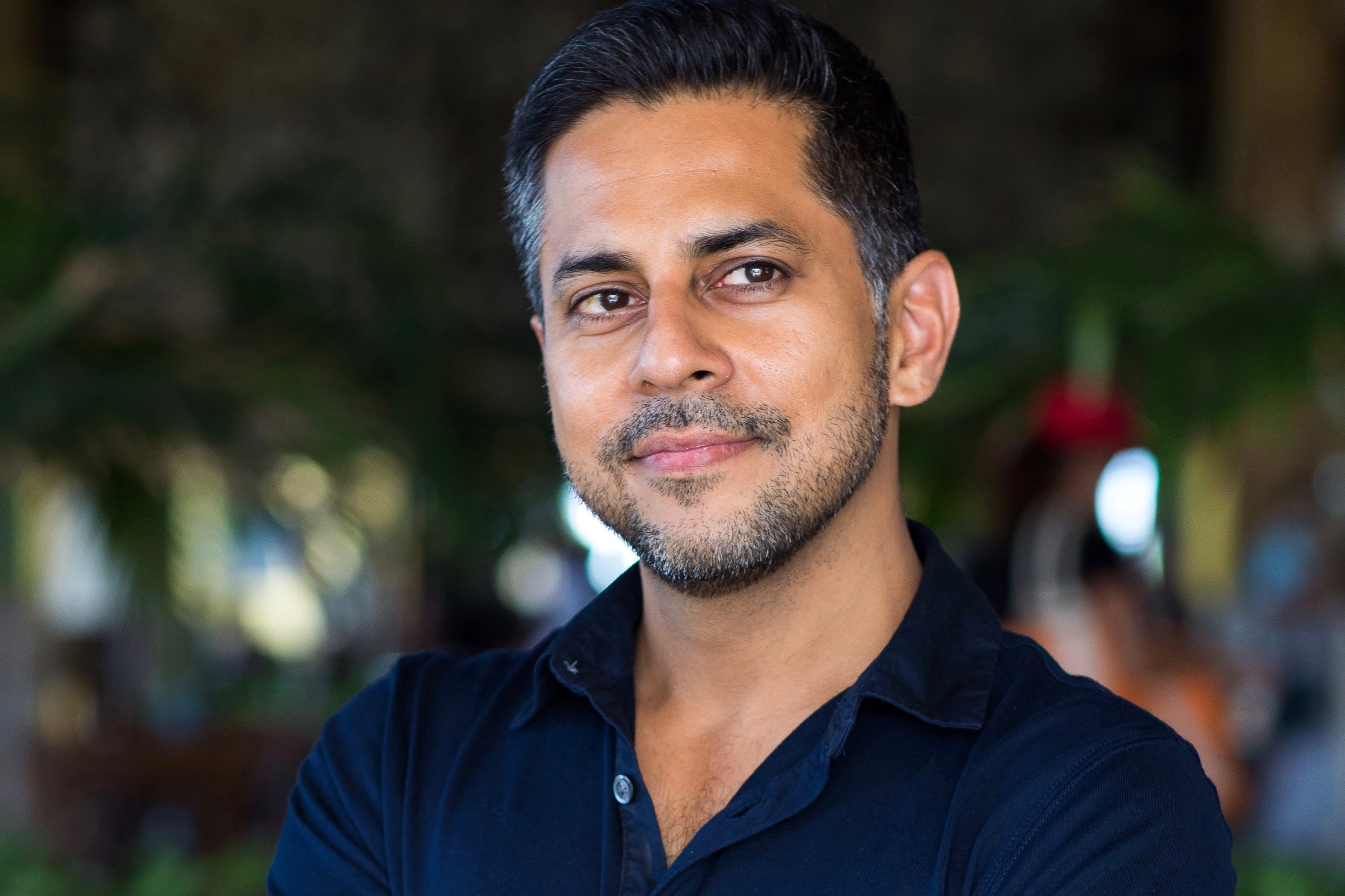 Vishen Lakhiani, the founder of Mindvalley looking very confident and content towards the camera.