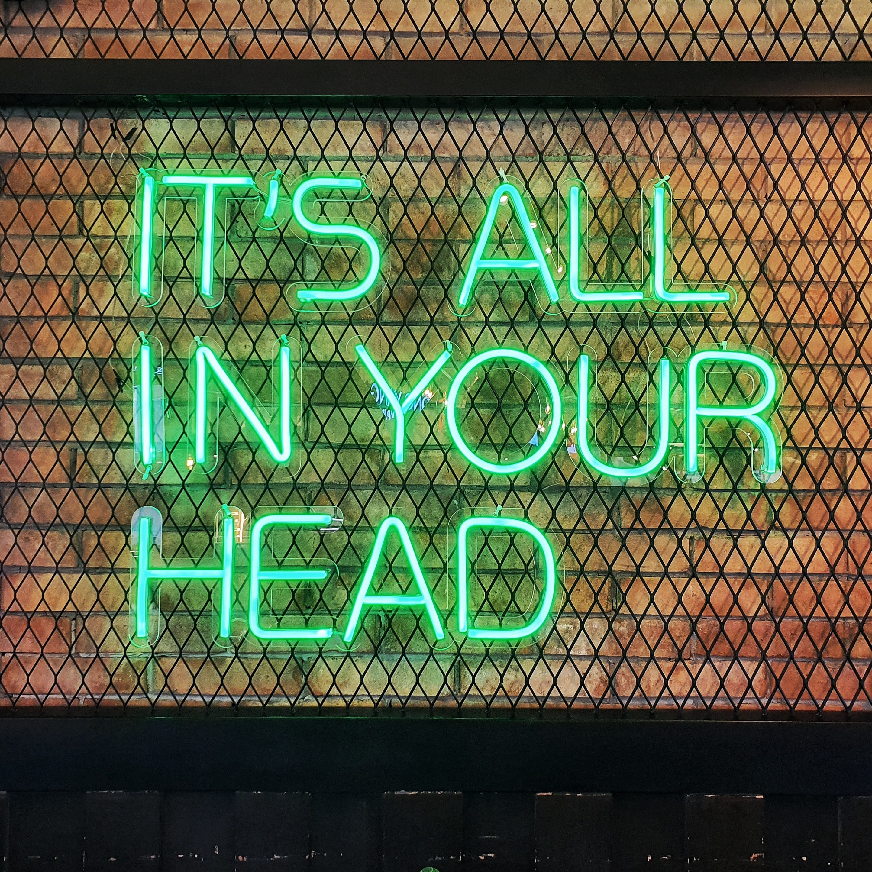 blue and white It's all in your head neon signage—how to stop being negative
