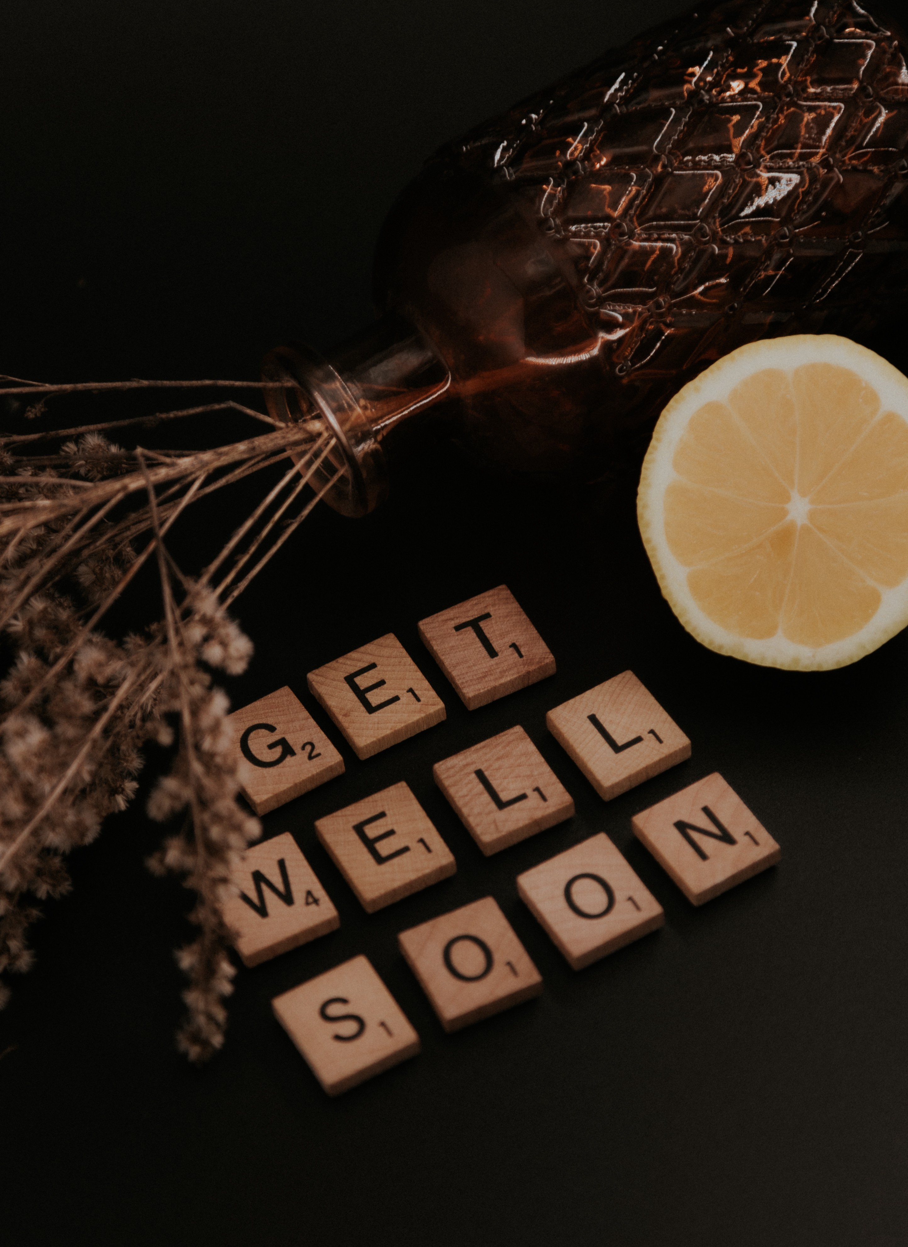 Wooden letter tiles spell out 'Get Well Soon'