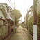 A slightly filtered image of a small neighborhood street in Japan.