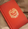 A red hardback copy of A Christmas Carol with gold foil on the embossed title.