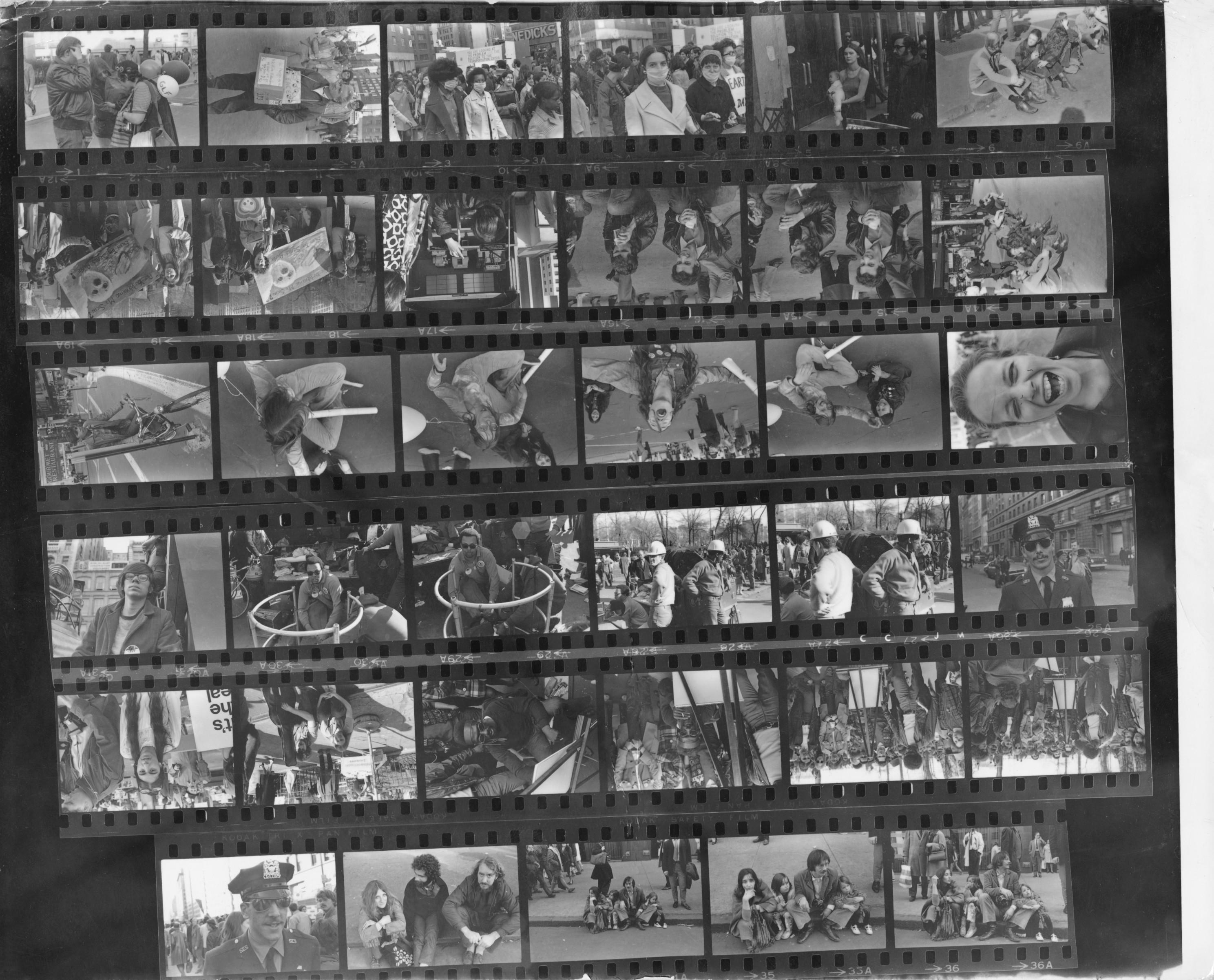 A contact sheet of photos of protestors and marchers at New York City's first Earth Day event in 1970. Photos by Dan Jaffe