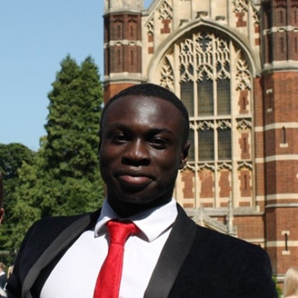 The author, smiling, at Selwyn College, Cambridge