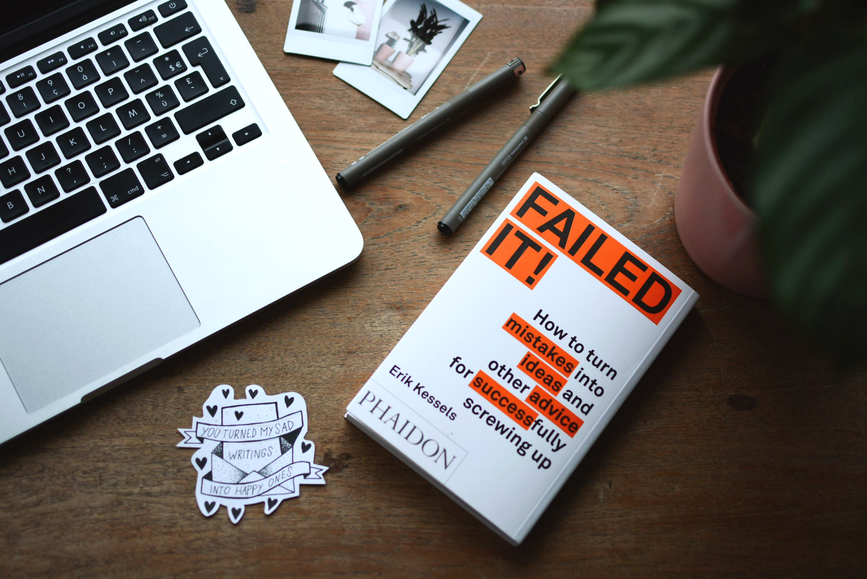A book on a desk. The cover mentions turning mistakes into successes.
