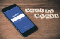 A cell phone tuned to Facebook, with Social Media spelled out in Scrabble tiles