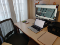 Image of a desk with a laptop, monior and a desk chair