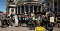 """The SAFE team and supporters in 2019 outside Parliament delivering their 30,000 strong call to end live export. There are about forty people standing in a group, many of whom are holding signs that say """"end live export"""". Some people are holding illustrated images of chickens and cows."""