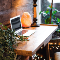 Picture of a desk with a laptop and a salt lamp