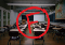 Red F with circle over image of classroom with empty desks