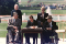 George H. W. Bush signing the Americans with Disabilities Act outside surrounded by two men in wheel chairs and two others