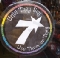 """Circular sign on a cafe door, around the edges are rainbow colors and the text """"Until they say, use them or they"""""""