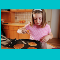 Child making pancakes in a kitchen