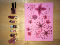 """A row of lipsticks sit alongside a """"drawing"""" of pink flowers, created with the makeup."""