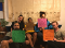 A group of young people holding signs in support of better housing solutions.