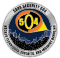 A challenge coin depicting a city and a searchlight with the numbers 504 inside it