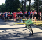 Crowd of cyclists at the dedication of a ghost bike for a person killed while riding his bike in Sandy Springs, Georgia