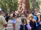 People gather at the base of a gigantic tree, the General Sherman sequoia, taking photos