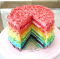Cake made up of rainbow layers, with one slice cut out from it.