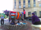 Me, Leslie Stahlhut, doing some final seaming on a yarn bombing of Major Bull in downtown Durham, North Carolina