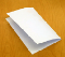 A blank sheet of paper folded in half