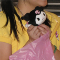 cropped photo of a young woman holding a small, stuffed toy of Sanrio character Kuromi