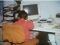 Young girl studiously at work in front of a vintage PC