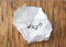 Crumpled paper with 'why?' typed on it.