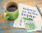 Image of a coffee cup with a napkin that says reducing my carbon footprint and then a list. The image also shows a calculator.