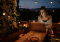 beautiful woman outside on laptop at night