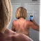 photo of a woman's back with bad tan lines