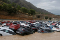 The image shows hundreds of cars pilled up covered with water due to the floods in 2019