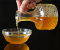 <img src='https://www.thespruceeats.com/argan-oil-uses-2394765'alt='A person pouring a jar of argan oil into a glass bowl'>