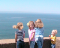 Four young children looking at an ocean view