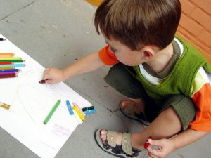 Boy draws, to illustrate childhood autism article
