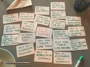 thoughts on joy in service - handwritten cards on cafe table