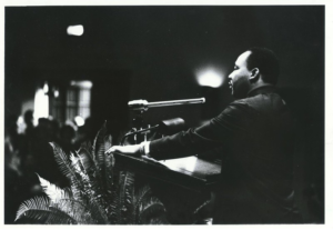Dr. Martin Luther King Jr. speaking in Page Auditorium on November 13, 1964.