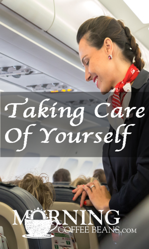 Airline assistant talking to passenger.