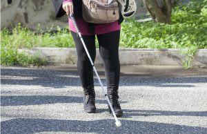 blind-girl-walking-with-cane