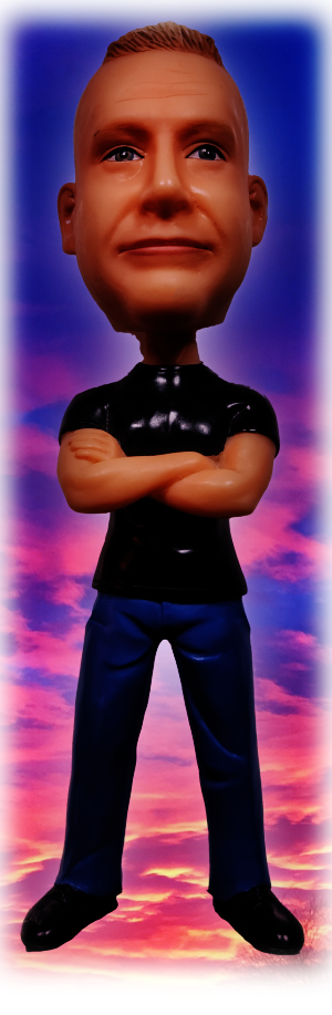 A photo of a plastic bobble head placed over a pink and blue sky.