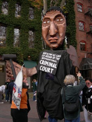 """Cardboard at a demonstration in Seattle, 2017: """"Why is the U.S. government so afraid of the International Criminal Court?"""""""
