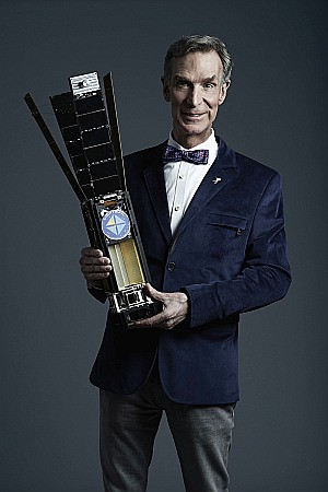 Bill Nye with a small satellite.
