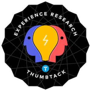 The Thumbtack research sticker. The logo is a lightbulb surrounded by two heads with a black background.