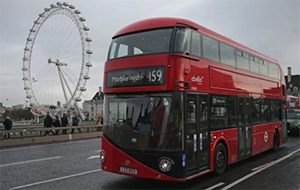 A bus in London with the London Eye in the background