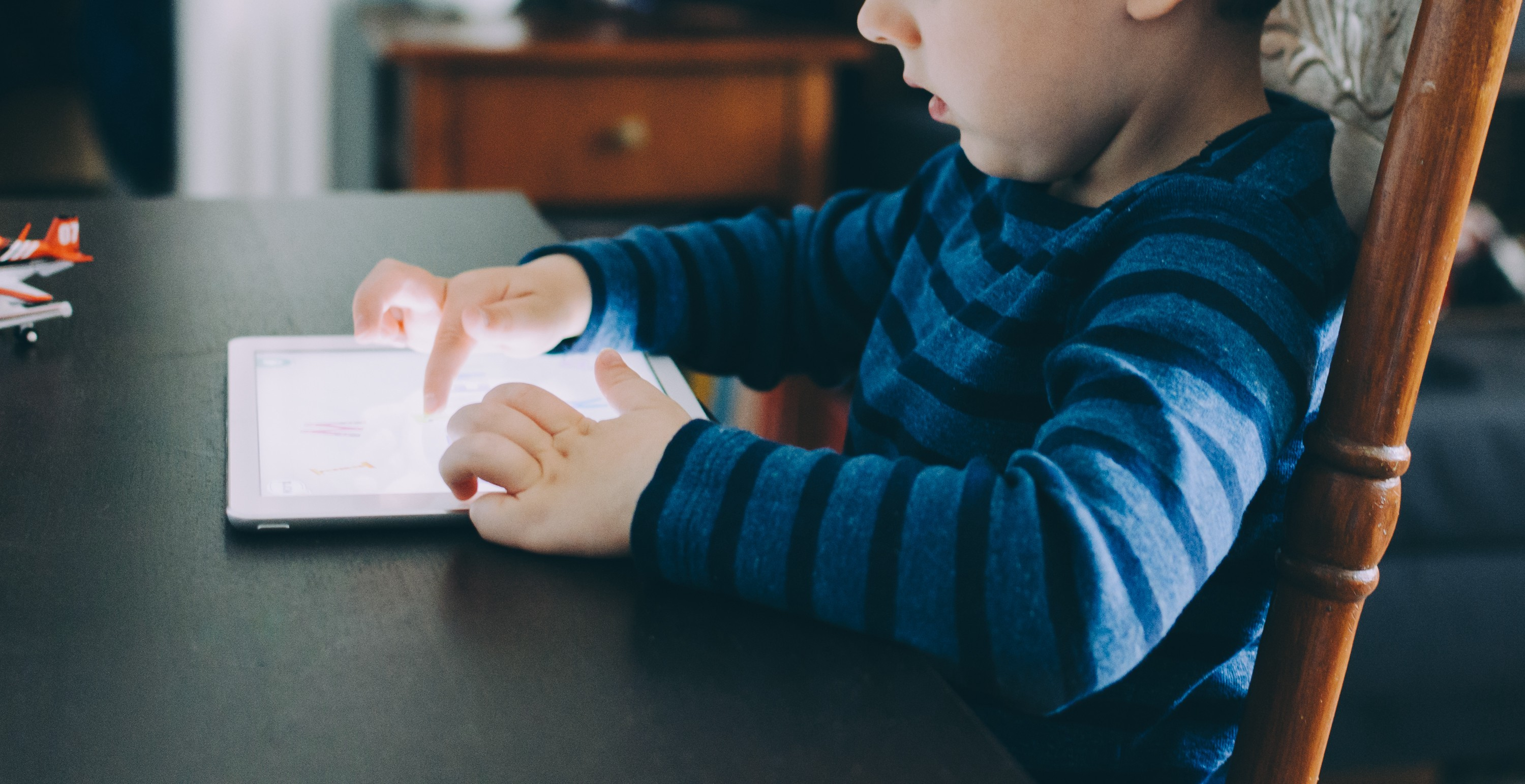 A child using a tablet