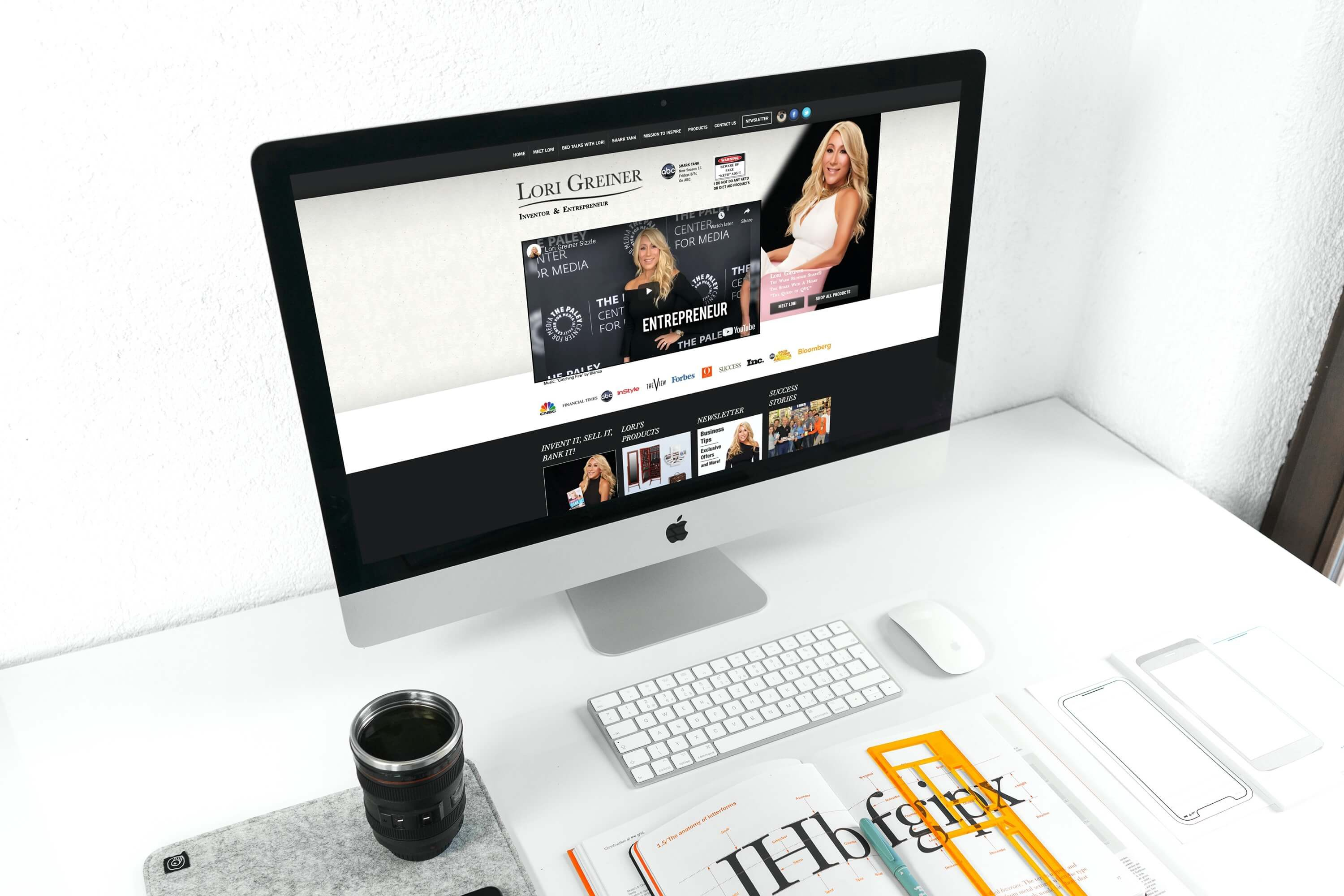 An iMac computer with Lori Greiner's website loaded on the screen.