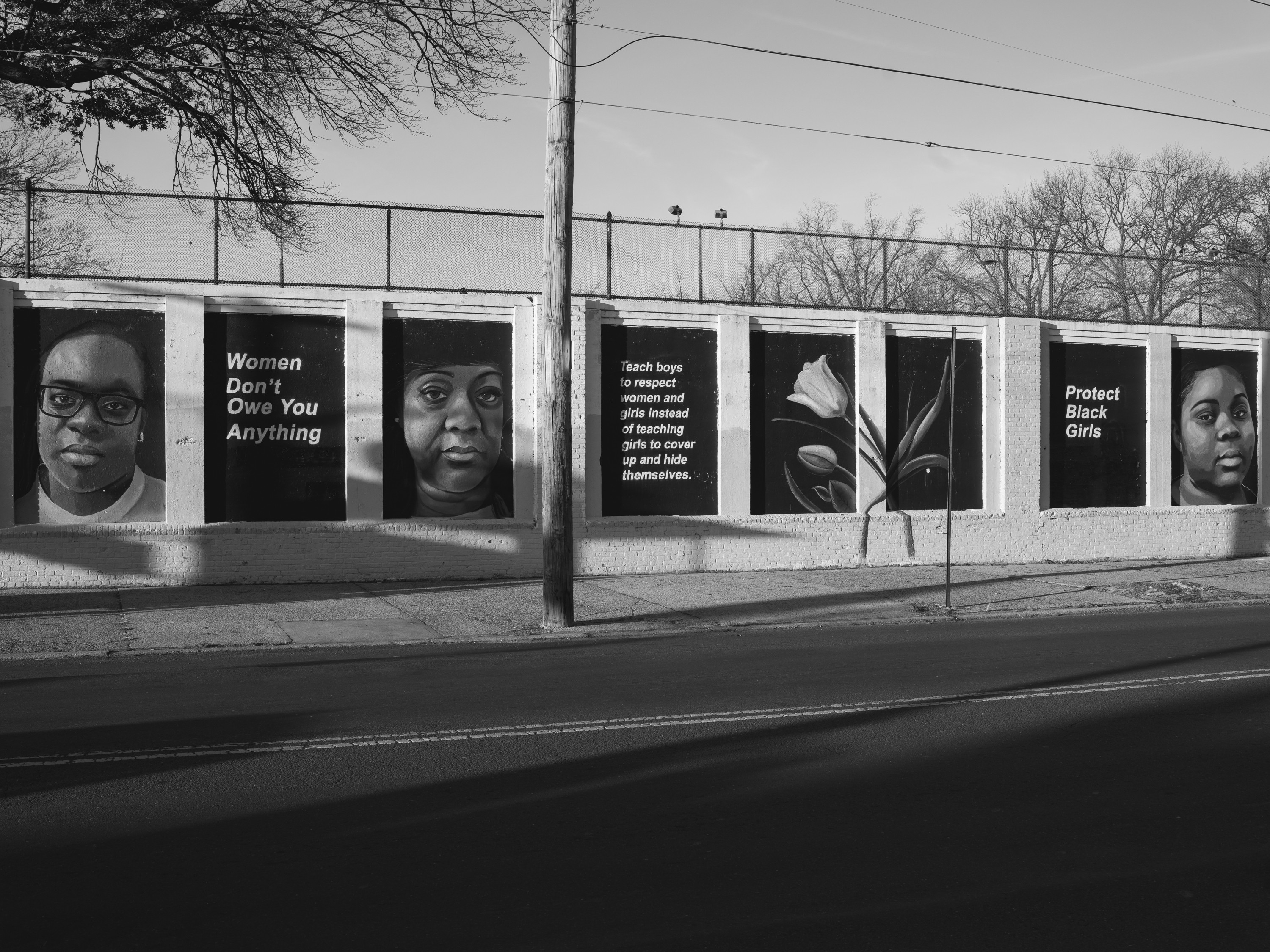 A mural in Queens created by artist Tatyana Fazlalizadeh represents community conversations and faces of Queens-based women.