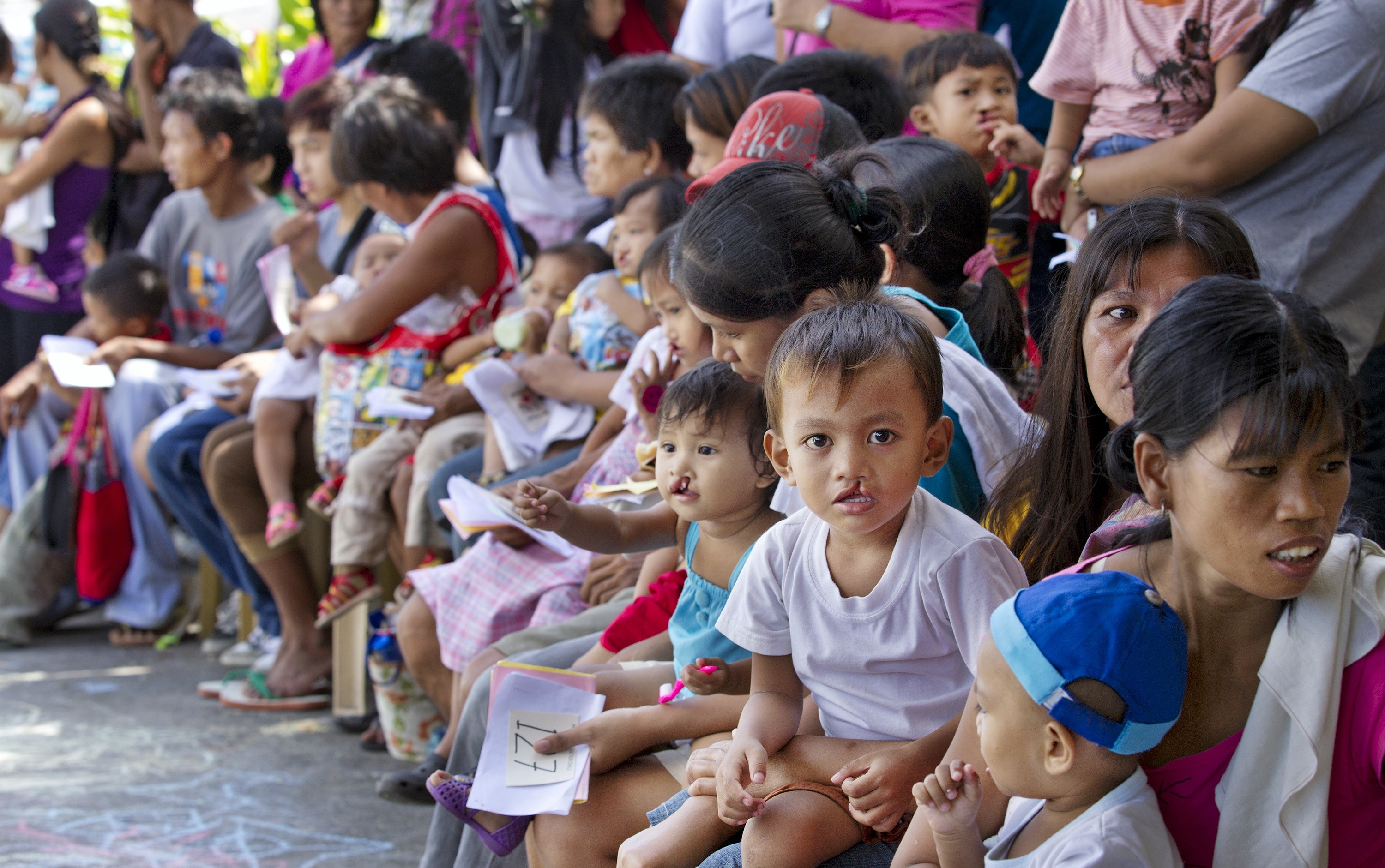 A crowd of families waiting for a health screening at an Operation Smile mission in the Philippines