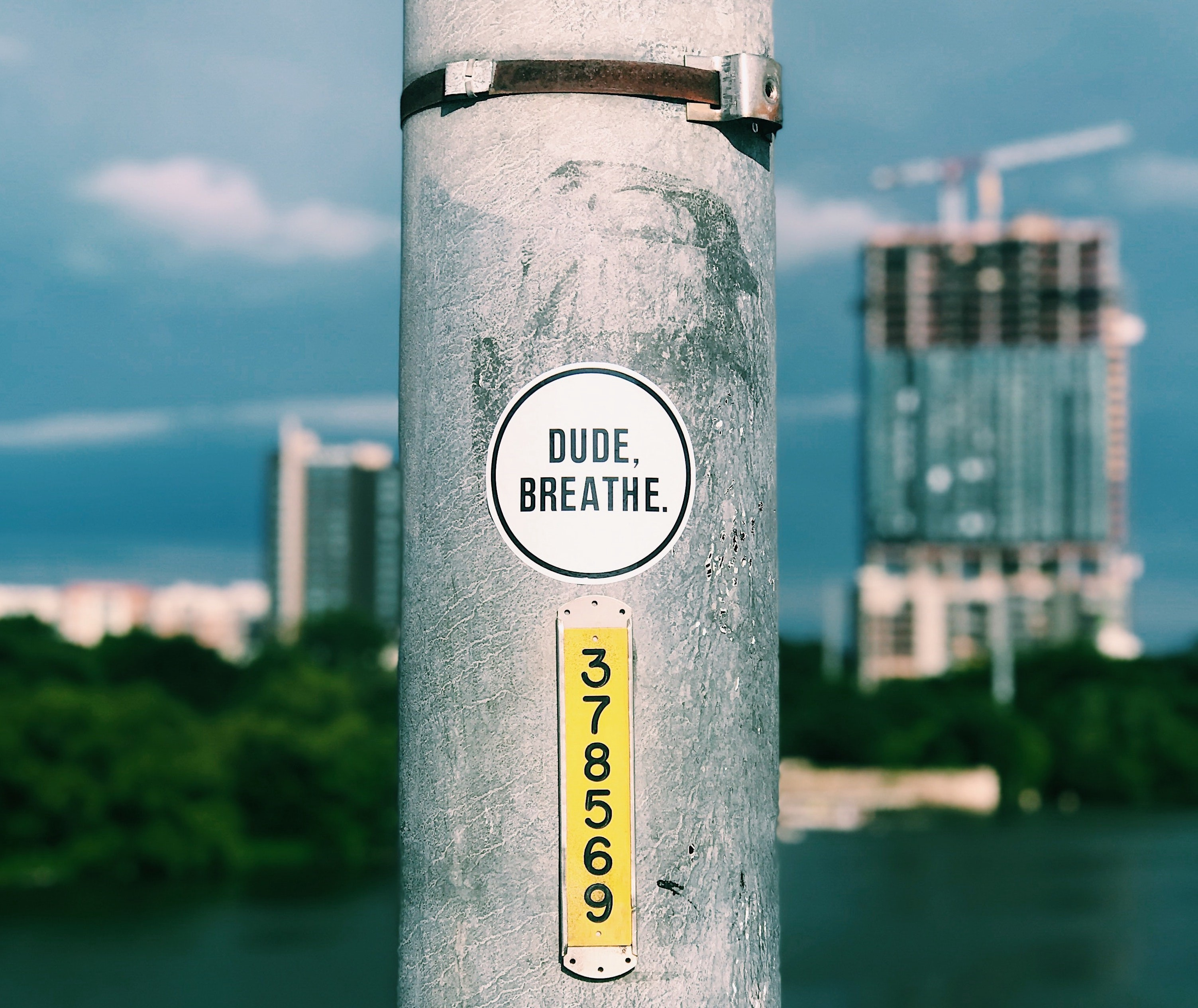 metal pole with dude, breathe sticker