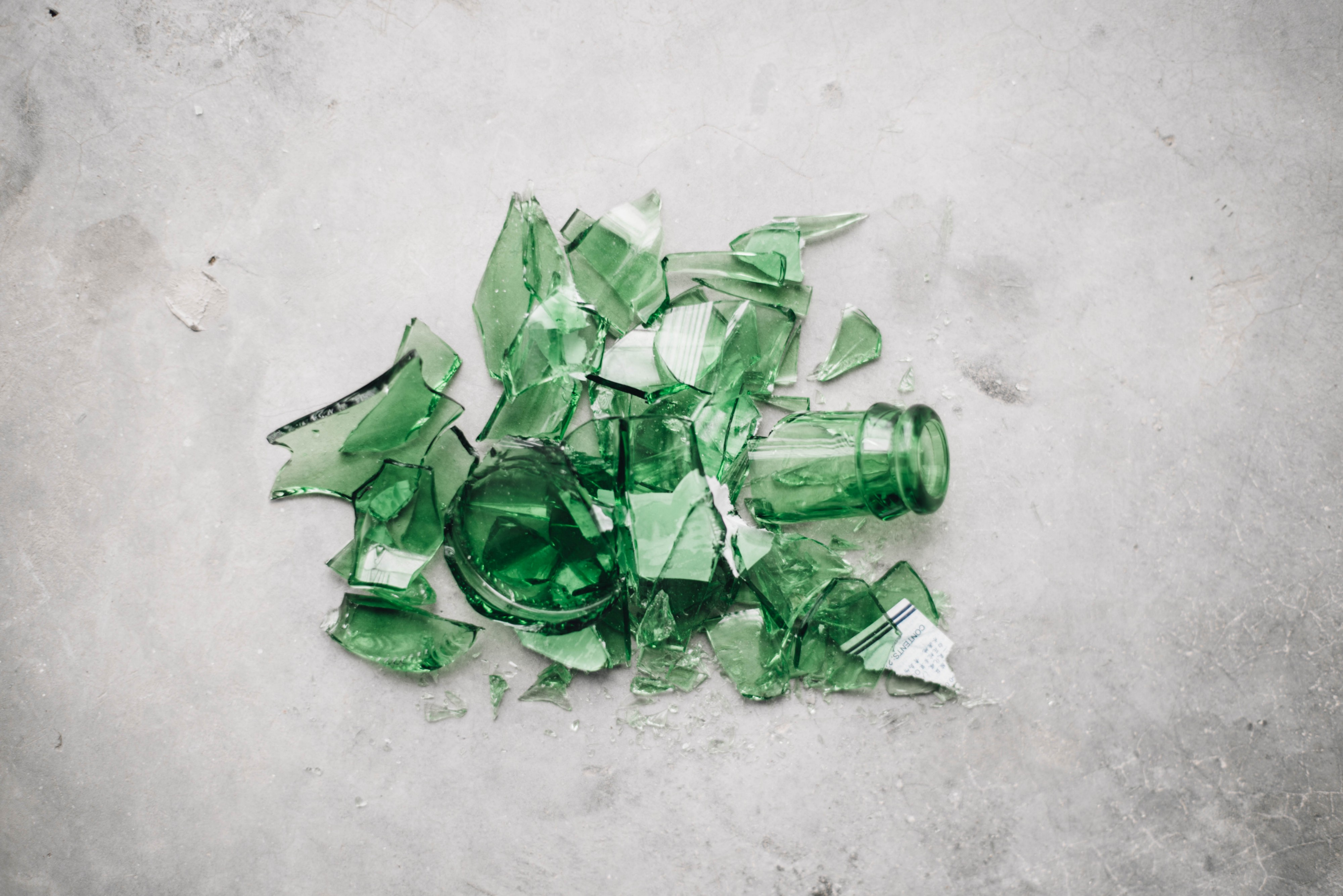 A green shattered glass bottle