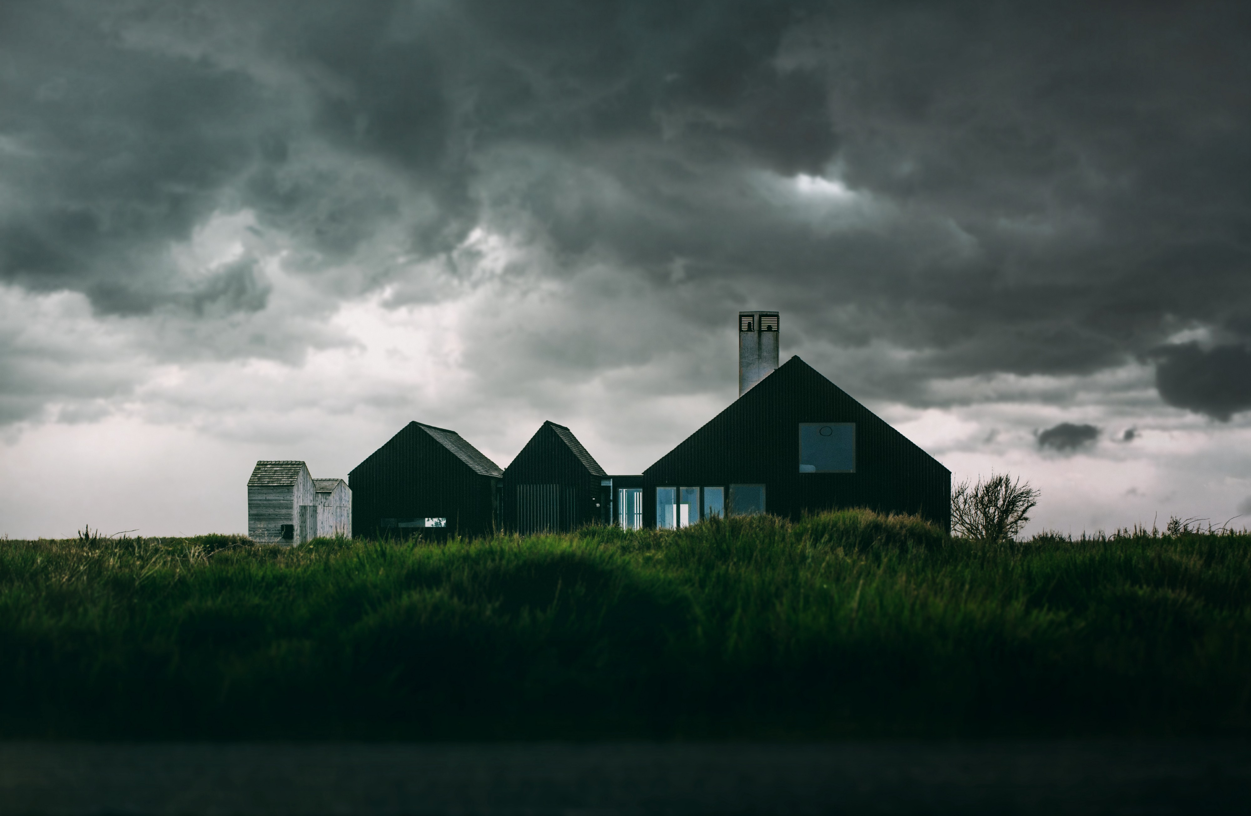 houses in a stormy landscape